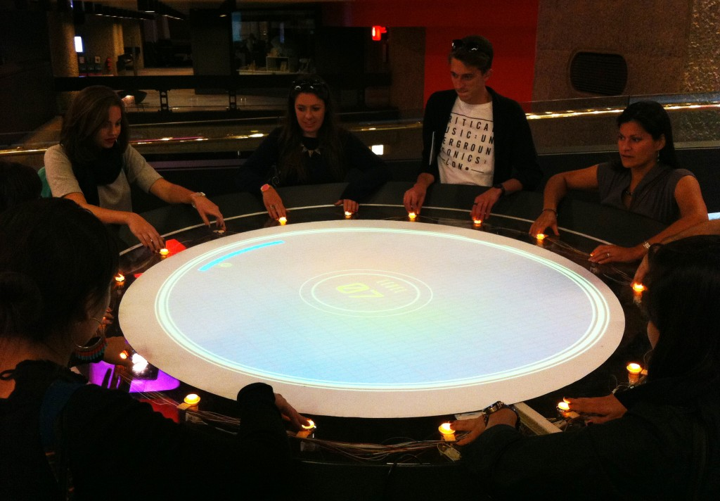 Barbican visitors play 'Donut Pong', by digital production studio Special Moves and Joe Scarboro - Image: Authors Own